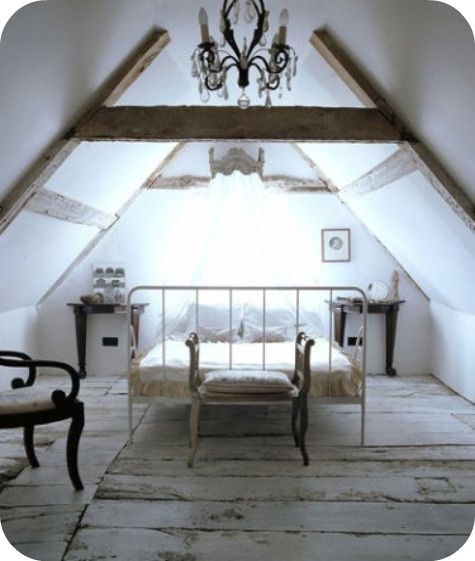 [attic bedroom - low ceiling, no box spring, half night stands...]