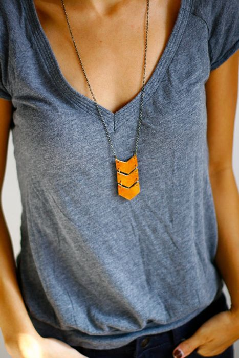 Triple chevron leather necklace- This link sends you to a place you have to register to see details and order its like $29 bucks too for some yellow leather strips attached together to make a chevron pattern? But I still love!