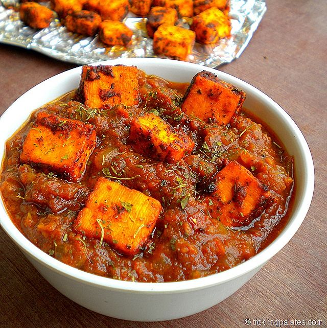 Paneer Tawa Masala - Grilled cottage cheese cubes cooked in tangy tomato gravy.