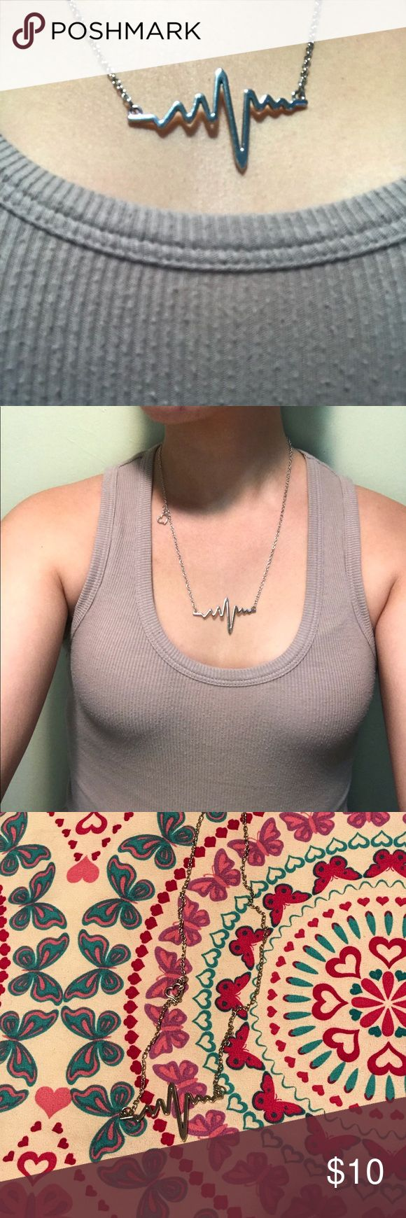 Heartbeat Electrocardiogram Necklace I purchased this necklace when I dedicated myself to the nursing field. I have never worn it as much as I thought I would. It is a brand new dainty stainless steel electrocardiogram necklace. It can be worn for yourself or as a perfect gift for a nurse. Jewelry Necklaces