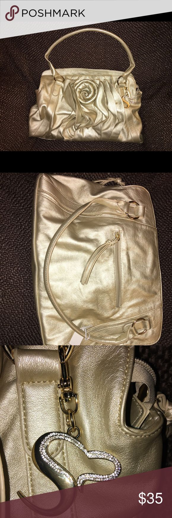 """Serena Williams Gold handbag Really nice.  """"Pleather"""" material, super soft. No rips or tears in lining. Some cracking in tassels. serena williams signature statement Bags Shoulder Bags"""