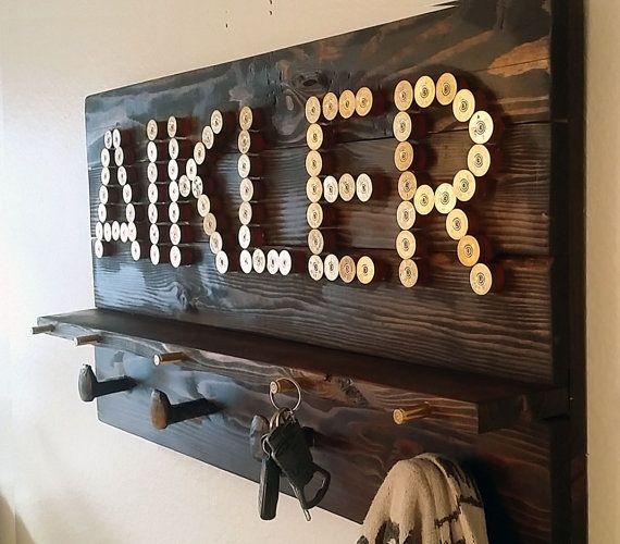 Custom word coat rack and key rack with shotgun shells, bullet casings, and railroad spikes