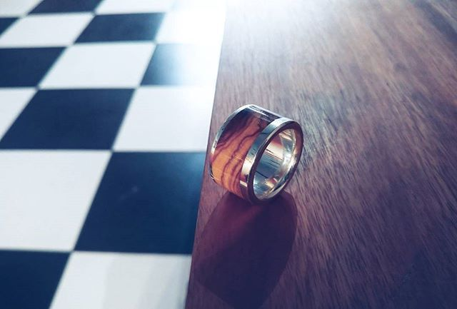 Broad olive wood and sterling silver band with a really beautiful grain