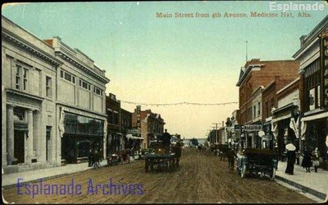 Looking east down Main Street (Second Street) from Fourth Avenue (Sixth Avenue). Shows Merchants Bank of Canada, Beveridge Block, Hollinger Agency, Jim's Cafe on north side of street, Monarch Theatre, confectioners, real estate, grocer and hardware stores on south side (ca. 1910). from Esplanade Archives Photograph collection.