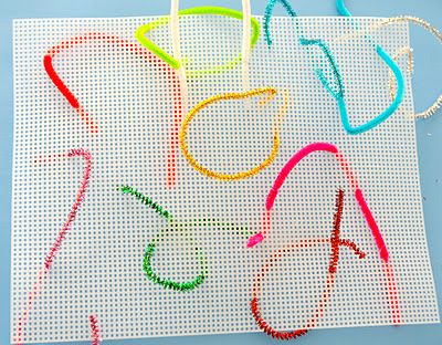Pipe cleaners + plastic canvas = a fun fine motor activity