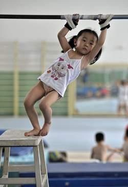 Keerzijde van de medaille: Spartaanse jeugdkampen voor Chinese talenten - Londen 2012 - De Morgen