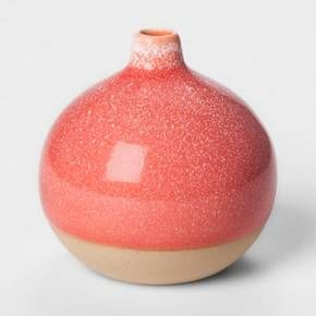 A contemporary tabletop and small space accessory, the Round Stoneware Vase from Project 62™ adds a vibrant hint of color to any room. This vase features an oversized round body with a tapered spout that holds flowers and other decorative materials. This pink stoneware vase is made of high-quality stoneware and finished with a glossy ceramic glaze.<br><br>1962 was a big year. Modernist design hit its peak and moved into homes across the country. And in Minnesota, Target w...