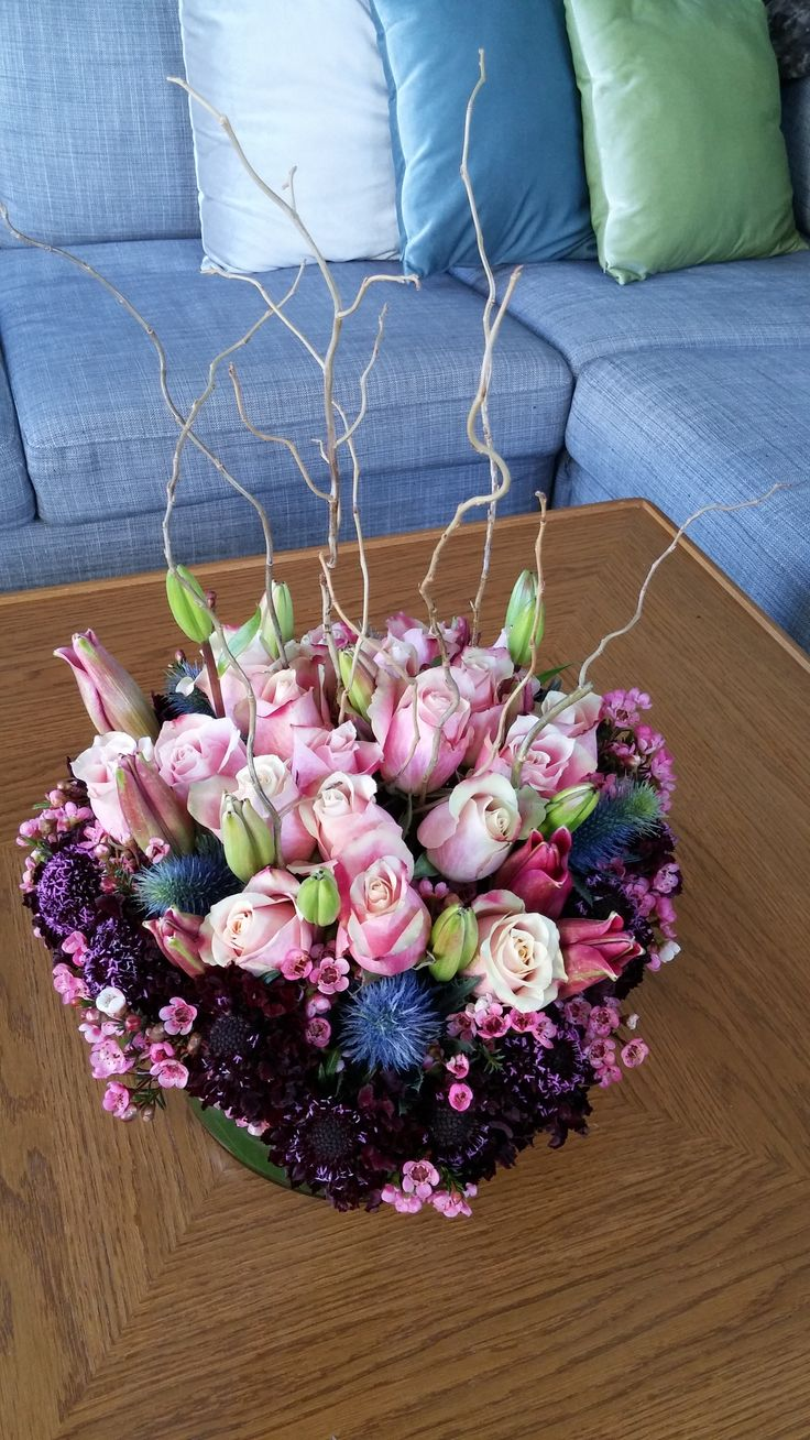 FLOWER BOWL featuring roses, scabiosa, sea holly, lilies and willow.