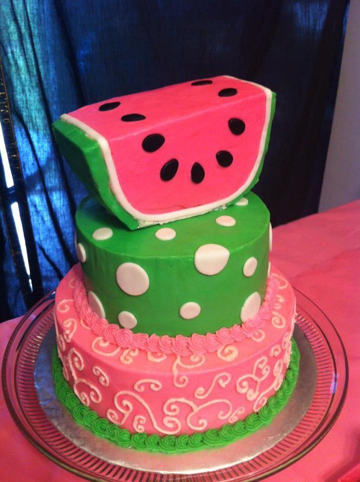 A three tier watermelon themed birthday cake.