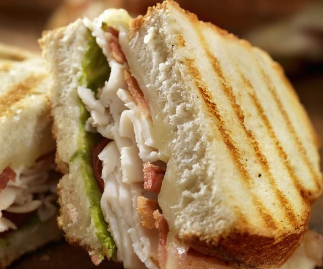 This chicken panini sandwich recipe is made with grilled chicken, pesto and Italian cheese. Some chicken panini recipes use Italian bread, but I like sourdough for this chicken panini sandwich recipe.