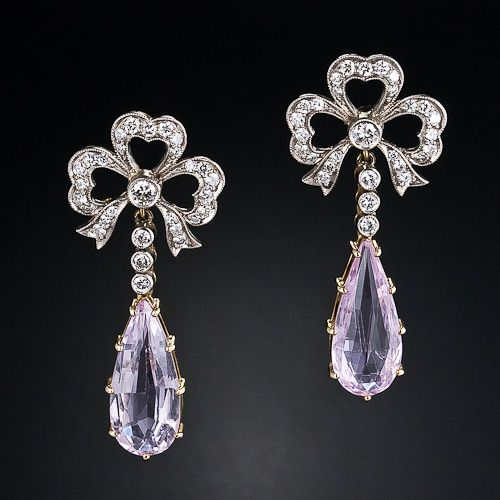 A dreamy pair of elongated pear shape, pastel pink topazes - set in 18k yellow gold - swing freely from delightful diamond bows rendered in platinum over yellow gold, in these ravishing and romantic drop earrings crafted in timeless Edwardian style. 1 3/8 inches long.