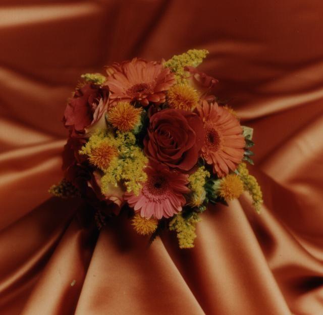 Fall bridesmaid - mini Gerbera, Solidago, Leonidas roses, Charlotte roses, etc. Photo by Judy Eliyas & Studio 925
