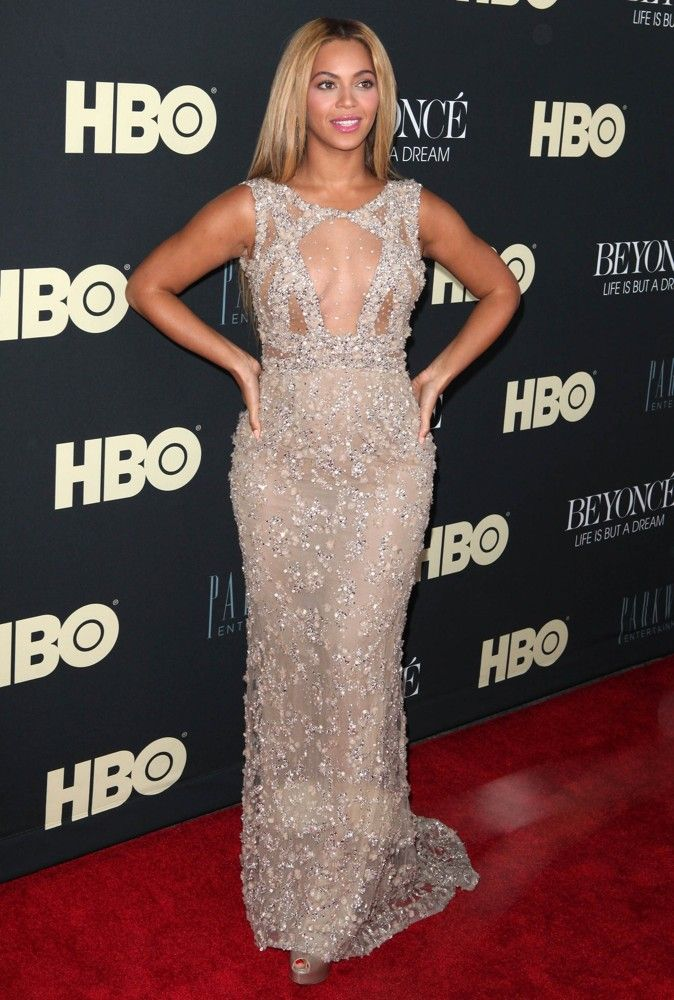"""Beyonce Knowles was glowing when she attended the premiere of her HBO documentary """"Beyonce: Life Is But a Dream"""" at the Ziegfeld Theater, New York on Tuesday, February 12. Looking absolutely stunning in a sheer beaded gown by Elie Saab, Beyonce posed for photographers and talked to the reporters."""