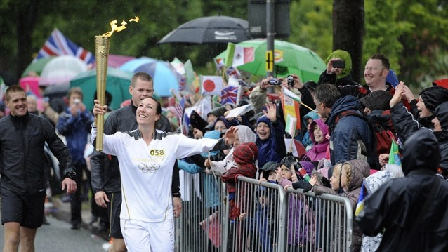 Our guest speaker at Refreshed, 17th May 2013 is Debbie. www.thewellretreat.co.uk/Refreshed  Olympic Team GB rower and Torchbearer Debbie Flood greets spectators as she carries the Olympic Flame on the Torch Relay through Lancaster.