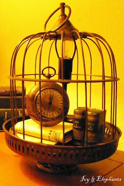 """maybe on a small table beside the reading chair, my favorite book inside ...  """"Time to Read Lamp"""" made from bird cage"""