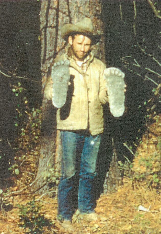 Roger Patterson, holding cast bigfoot footprints