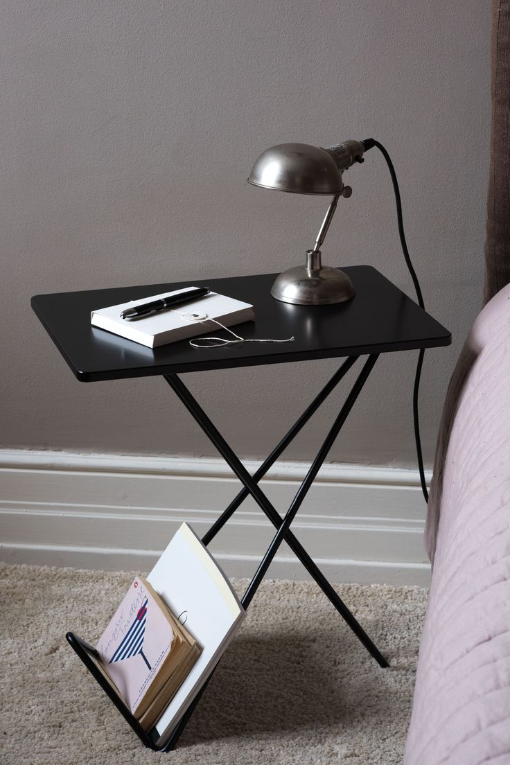 """Tiny is a neat table inspired from the famous """"Butterfly Chair"""" which was designed for the first time in Argentina in 1938. As the chair, Tiny suits both classic and modern interiors. It is a small and flexible side table and a magazine rack in a single piece of furniture."""