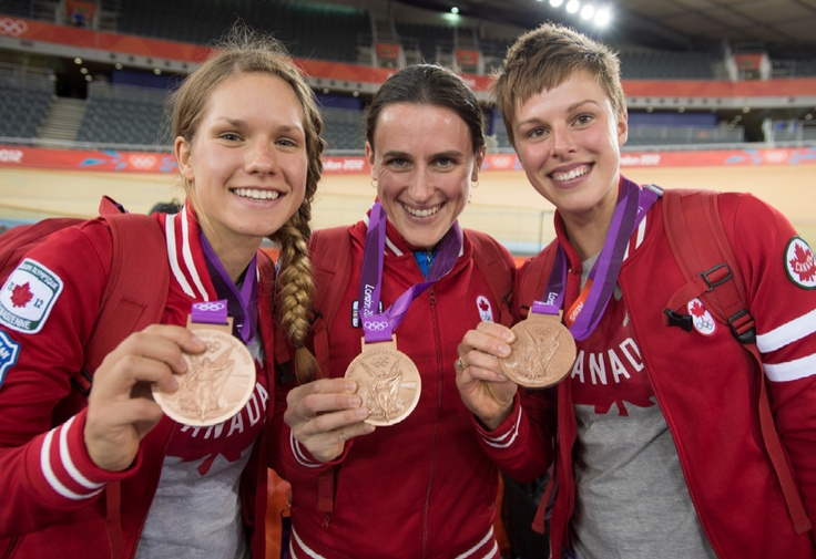 Canada's Jasmin Glaesser, left, Tara Whitten, middle, and Gillian Carleton hold their bronze medals from team pursuit in the velodrome at the 2012 London Olympics, August 4, 2012. Canada placed third behind Great Britain, gold medallists, and the United States.  COC Photo: Jason Ransom