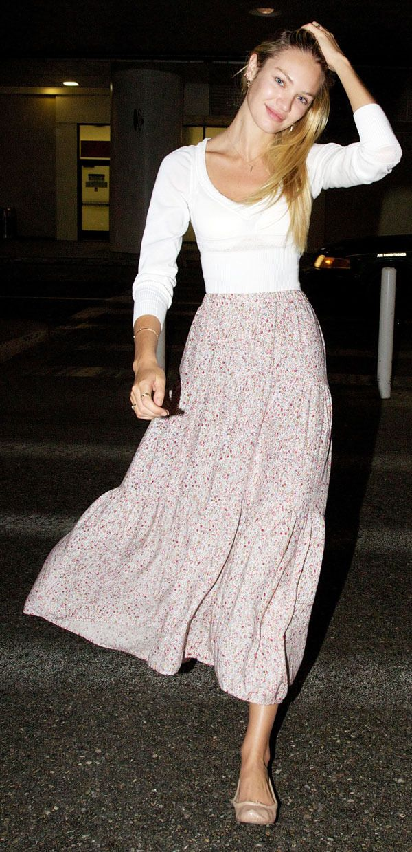 Candice Swanepoel- Im hunting for these kind of skirts now!