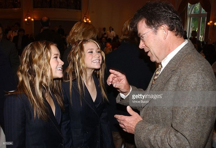 Publisher Robert J. Dowling (R) talks with actors Ashley (L) and Mary-Kate Olsen at the unveiling of the Hollywood Reporter's 10th Annual Women In Entertainment Power 100 list December 4, 2001 in Beverly Hills, CA. The event honors the top 100 women in the entertainment industry.
