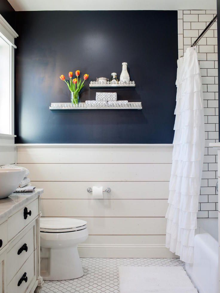 Navy Accent Wall Over White Shiplap in Country Bathroom With Subway Tile Shower