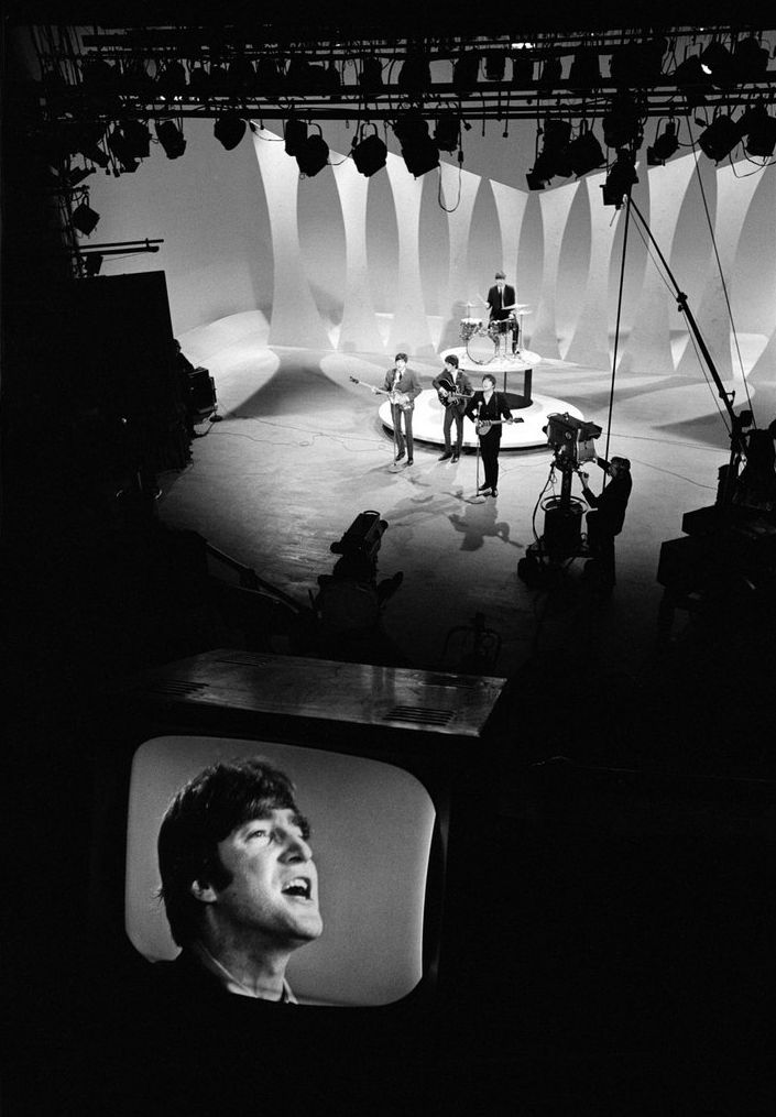The Beatles (John on the monitor) in A Hard Days Night (1964), directed by Richard Lester