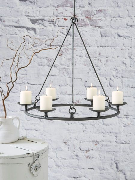 Bring some romantic lighting into your home with our stunning new pillar candle chandelier.