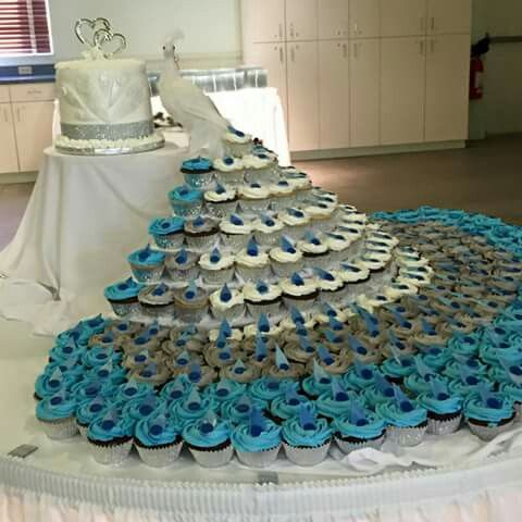 Peacock wedding cake & cupcake display                              …