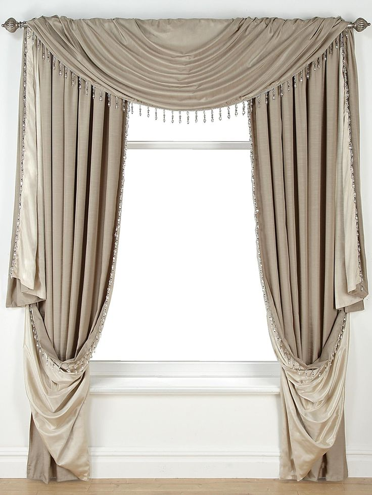 £49 Laurence Llewelyn-Bowen Grand Finale Reversible Faux-Silk Slot Top Curtains in 4 colour options From the master of dramatic décor, Laurence Llewelyn-Bowen, comes the stunning Grand Finale curtain range, which will make a theatrical feature of your window.In a sumptuous faux-silk, the curtains feature an intricately beaded edging and are available in four striking colour combinations: taupe/natural, wine/red, heather/purple and charcoal/black....
