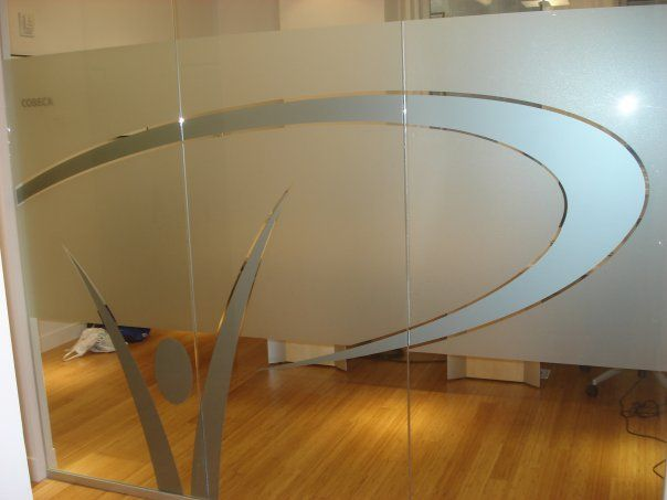 Custom Frosted Vinyl And Metallic Silver Applied Reverse Onto Interior Office Glass Panels In NYC