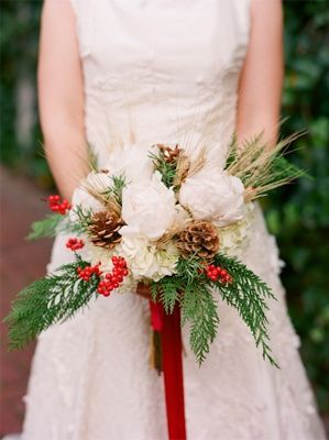 Advent Day 22: Christmas flowers  We just adore this festive bouquet for a Winter Wedding!