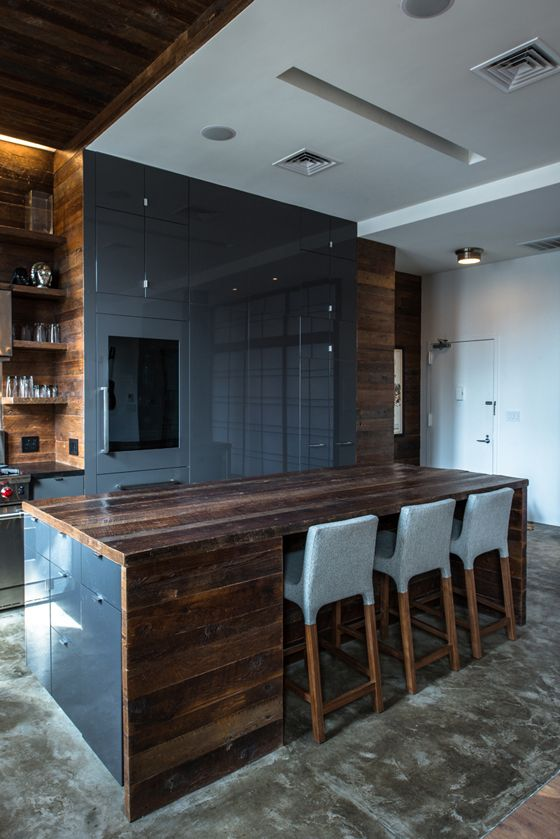 East Village Kitchen featuring a custom island with reclaimed wood surfaces and high-gloss cabinet faces.