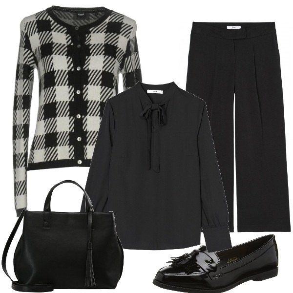 Una camicia con fiocco viene abbinata d un paio di pantaloni ampi. Sopra si può indossare una giacca a quadri in bianco e nero. Le scarpe sono dei mocassini con nappina e la borsa a mano ha anch'essa una nappina.