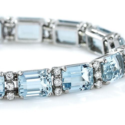 Vintage Aquamarine, Platinum and Diamond LIne Bracelet - 15 matched emerald cut aquamarines, total 35 carat alternate with trio of bright white, full cut diamonds, 1.35 ct VS G-H. Mid-20th century