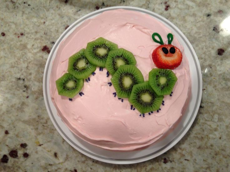 For my daughter's first birthday, we had a very hungry caterpillar theme. I made her smash cake myself. The cake was Duncan Hines white cake mix and a can of club soda (she is allergic to eggs and milk) and the frosting was a can of coconut cream chilled in the fridge overnight, then whipped with a few teaspoons of maple syrup. For the very hungry caterpillar, I used kiwi, strawberries, and snippets of blueberries for the eyes! So easy and so fun!