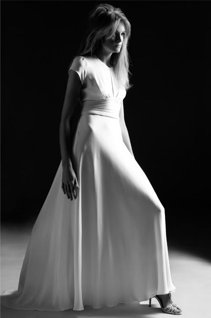 Forties vintage inspired wedding dress with cap sleeves and quilted waist for a classic vintage wedding dress silhouette