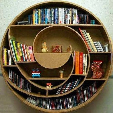 Cool bookshelf image via Namaste Cafe at www.Facebook.com/NamasteDharmaCafe