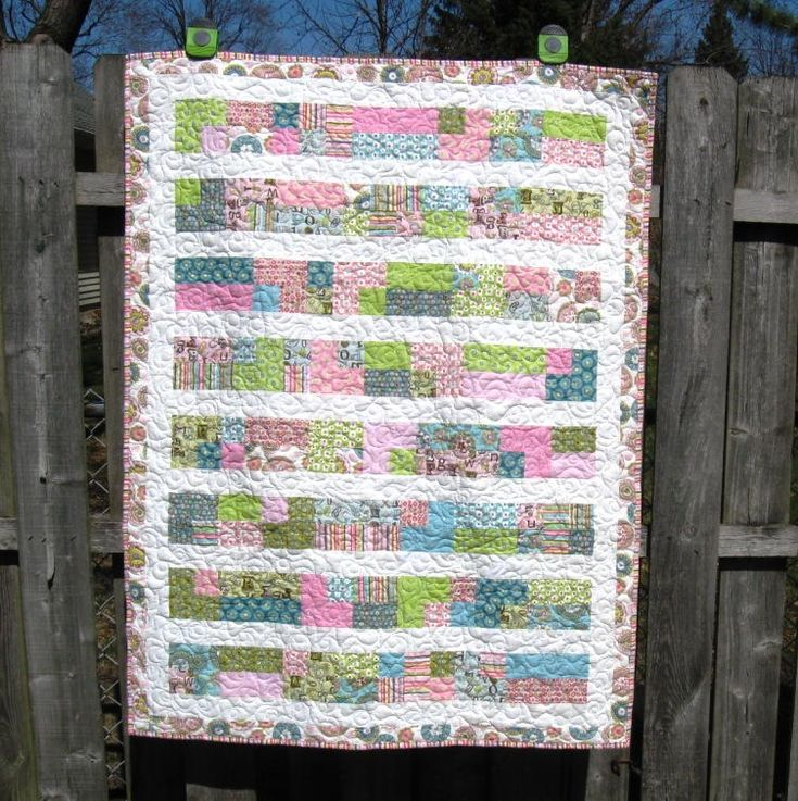 A Stroll Down Penny Lane Quilt | This pretty baby quilt takes only a weekend to make and uses jelly rolls!