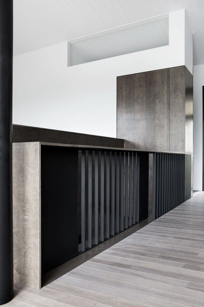 Very modern millwork with some sort vertical front panels  La Sentinelle by NatureHumaine