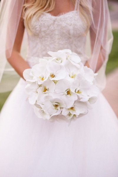 Hollywood glamor with orchids: http://www.stylemepretty.com/2015/11/22/sofia-vergaras-orchid-wedding-bouquet/