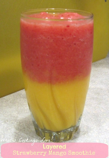Layered Strawberry Mango Smoothies.  These smoothies taste just as pretty as they look with a layer of strawberry and a layer of mango.  #smoothie #strawberry #mango