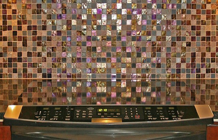 Oceanside glass mosaic tiles on kitchen countertop backsplash, under counter lighting to show off the quality tile work.
