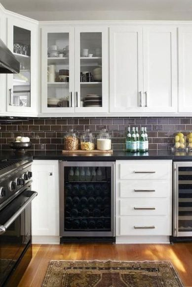 subway tile ideas on a kitchen backsplash. Love the chocolate brown with black granite and white cabinets
