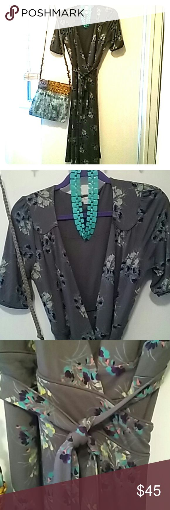 Boden gorgeous wrap dress US size 8L very flattering heavy viscose/elastane. Dark gray background with turquoise, yellow, pink, purple and black. Short sleeve with button detail. Good for all seasons. Mid length. Boden Dresses Midi