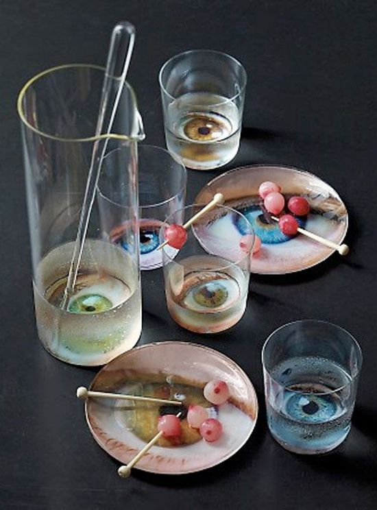 Eyeball tableware! This is awesome. Martha Stewart offers free eyeball clipart that you can enlarge or reduce in size to fit your glassware.  This website has a lot more cool Halloween drink ideas too.