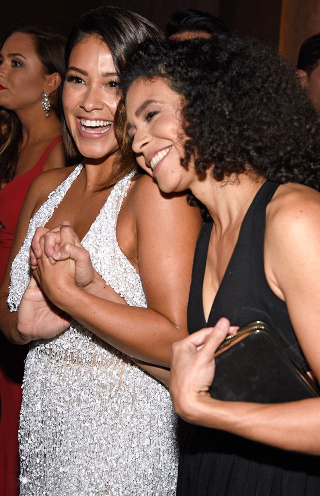 Gina Rodriguez & Rebecca Rodriguez from 2017 Golden Globes: Candid Moments  Sisters are doing it for themselves.