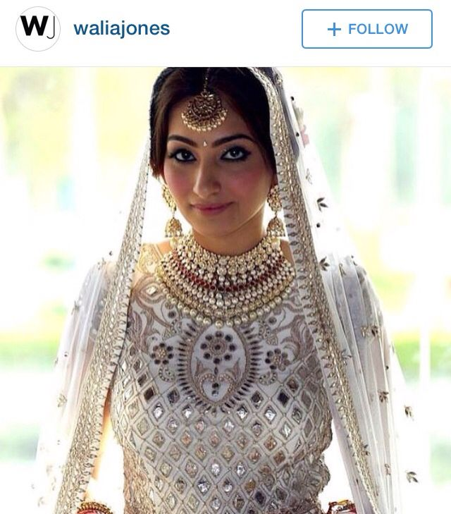 White Lehenga with pearl and gold jewelry