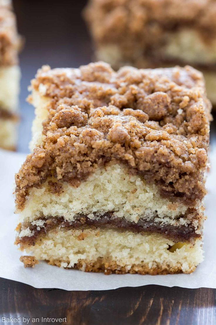 With a thick cinnamon streusel topping over fluffy, buttery cake and a ribbon of melty cinnamon through the center, this crumb cake is going to be a hit at your family breakfast!!