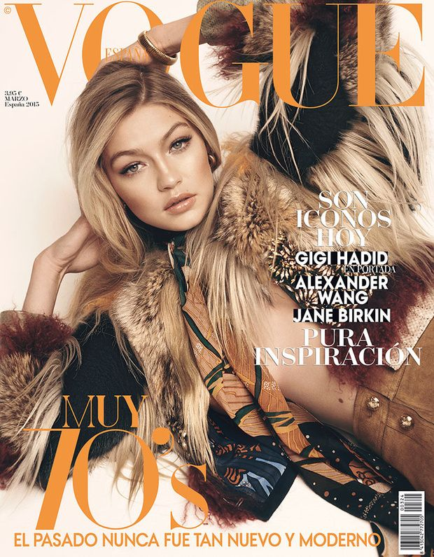 Gigi Hadid lands another cover for the March 2015 issue from Vogue Spain. The Sports Illustrated Swimsuit model wears a 1970s inspired fur look with camel suede pants from Gucci