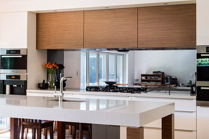 Wow, I had no idea that people had started doing glass splashbacks, but I love it! Something about it looks very classy and sophisticated. I think that trends like this will never go out of style because they are so timeless. My husband and I have been thinking about renovating our kitchen, so maybe we'll do something like this!